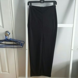 Long black maxi skirt with high slit in front