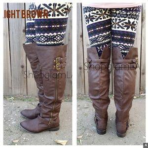 Light brown knee high riding boots