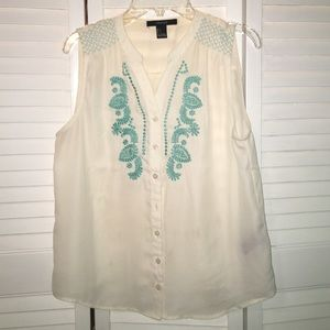 Sleeveless embroidered button up blouse