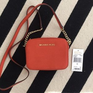 Michael Kors Handbags - Michael Kirs jet set travel Crossbody Orange