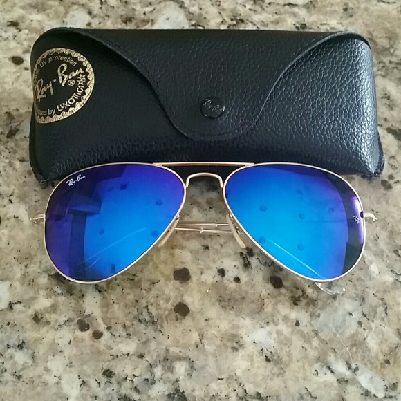 00ebc875c72a7 Blue tint Ray-Ban aviators with gold trim