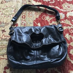 Black leather convertible bag.