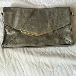 Silver snakeskin envelope clutch