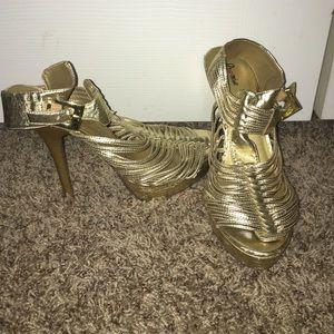 Gold stilettos!
