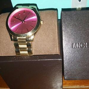 Michael kors gold watch.