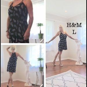 H&M razor back dress. Black with white feathers. L