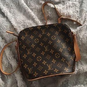 Handbags - Designer handbag L V