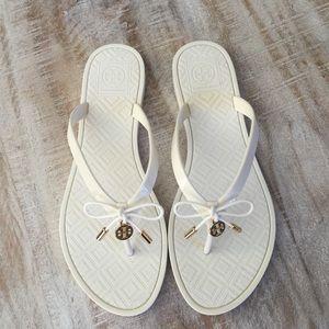 4b2899eb6cf5 Tory Burch Shoes - Tory Burch Jelly Bow Logo-Charm thong sandal wht