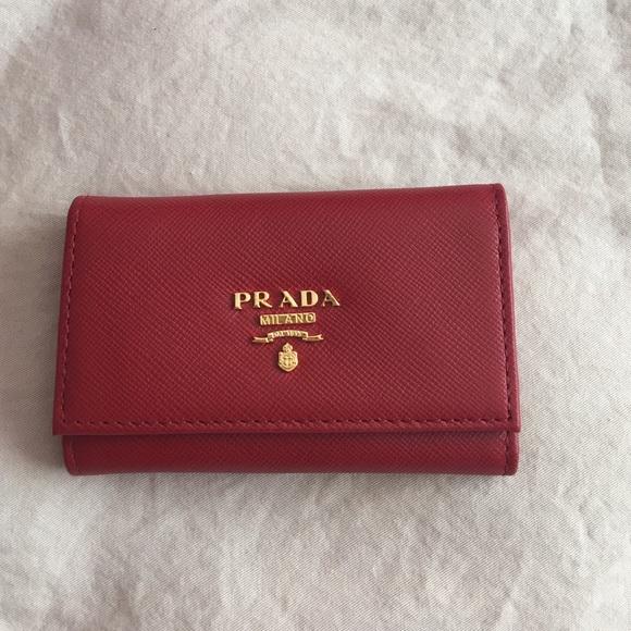 7c9094563c13 New Prada saffiano leather keychain holder pouch. M_57b8f096a88e7d696e00a788