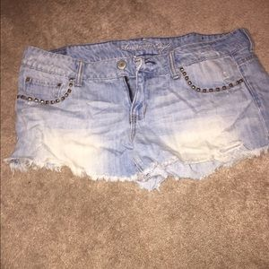Distressed studded light blue jean shorts