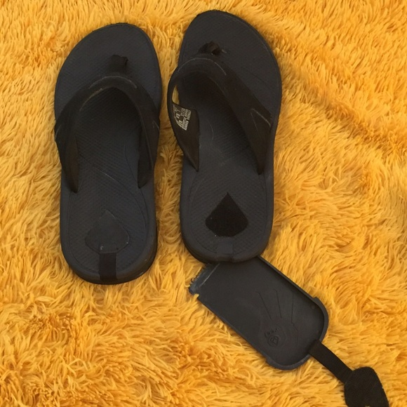 952ffcfe9596 Black Reef flip flops with secret compartment