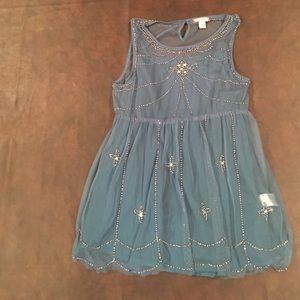 Girls blue fancy shirt.