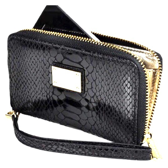 dd5c26531e38 Michael Kors black snake skin wristlet   wallet. M 57bbfb0d2de512074d007afd