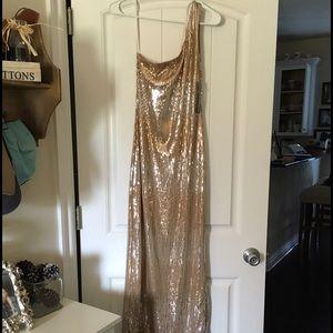 Gold/silver sequin one shoulder dress.