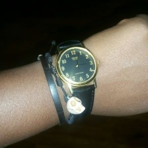 Black and Gold Casio watch