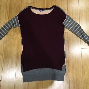 Striped knit sweater. Different on front  back.