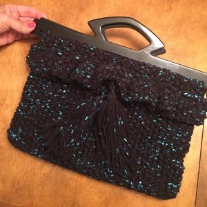 Handknit black and metallic turquoise purse