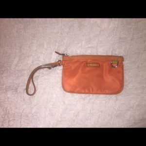 Tumi Handbags - Tumi orange wrislet