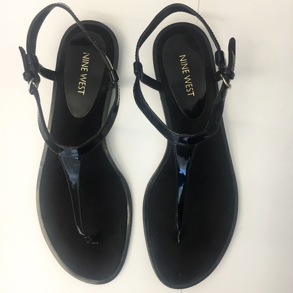 ac38ab774a0e Nine West T strap flat sandals. M 57bf3e68522b458ee9000701