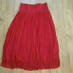 Anthropologie red pleated midi skirt.