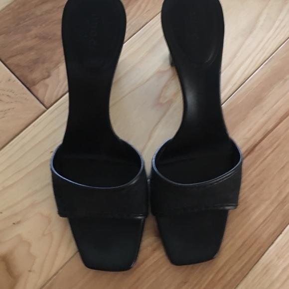 Gucci Shoes - Gucci black heels black mint condition