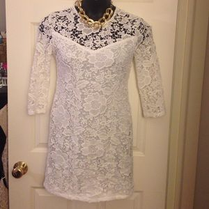 Formal long sleeved dress with floral pattern