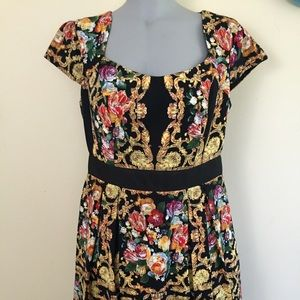 Dresses & Skirts - Gold and floral brocade dress.