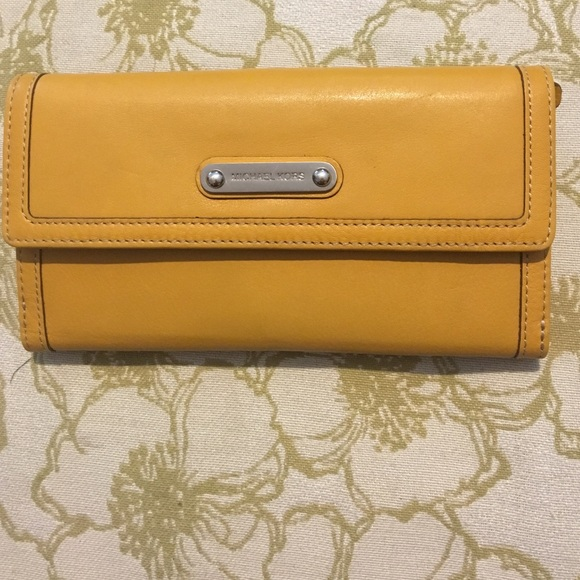 6a46f2de07c206 Michael Kors wallet - mustard yellow (authentic). M_57c3199c2ba50a5ccb03af1e