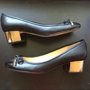 Black leather with gold heel
