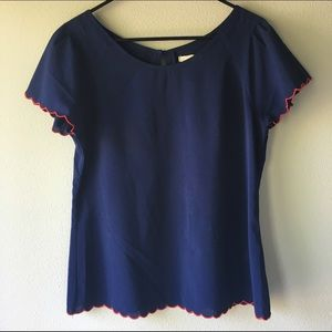 Navy blue scalloped blouse with red trim!