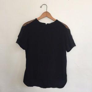 Black Zara top with sheer paneled shoulders