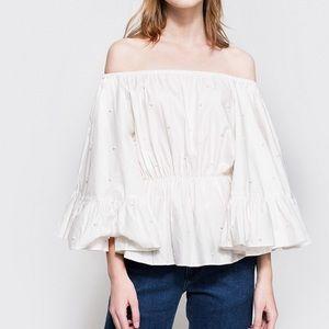 Off shoulder white top
