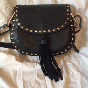 Black studded black cross body bag with tassel