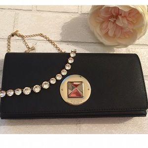 kate spade Handbags - Kate Spade Black Clutch Gold Hardware