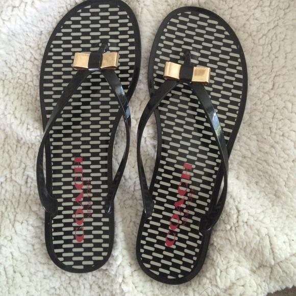 ce898d54926e Coach Shoes - Coach flip flops with gold bow