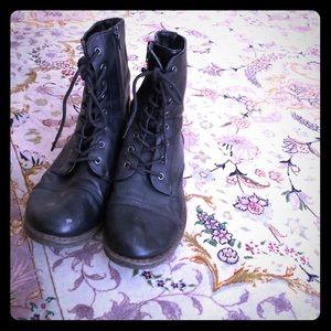 Shoes - Black leather combat boots.