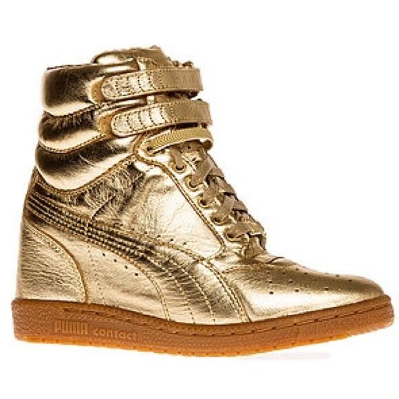 bdc594e1b260 Puma wedge gold sneaker heels. M 57c8ee84c6c7953d0f00bc20