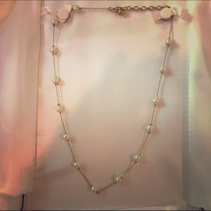 Gold tone chain with stationed cultured pearls