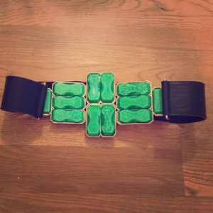 Super trendy black with green stone belt.