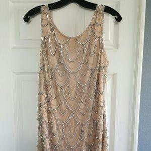 Short sequin Adrianna Pappell dress.