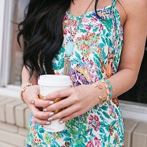 Graphic floral print tank with tassel detail