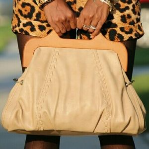 Tan bag with wooden handle