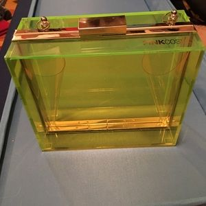 Neon fluorescent green lucite clutch