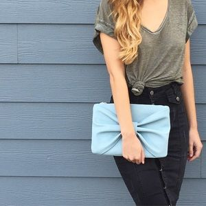 | new | blue bow clutch