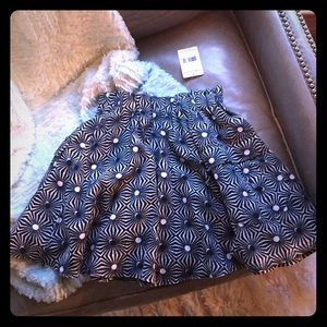 A cute vintage skirt that is new with tags.