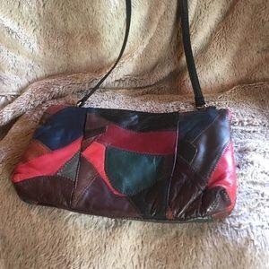Multi color cross body bag. Faux leather