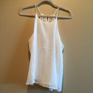 Em Tops - White silky top with detailing on back.
