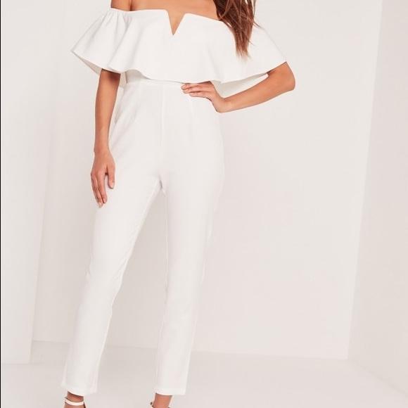 07d657e65d4 Missguided White frill Bardot jumpsuit. M 57cf56063c6f9f6170009de3