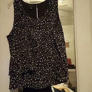 Sleeveless black and white layered blouse