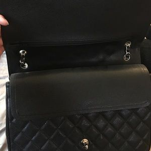 Inside of large Chanel flap maxi XL bag purse